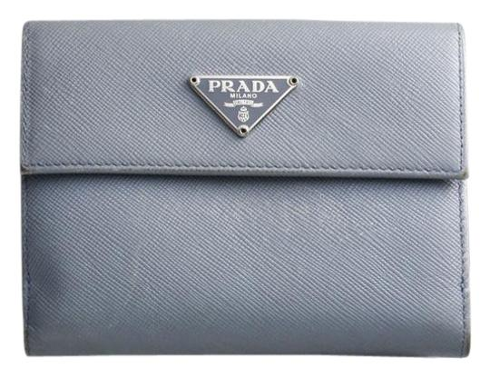 Preload https://item5.tradesy.com/images/prada-light-blue-saffiano-genuine-leather-w-hook-bifold-wallet-21569399-0-1.jpg?width=440&height=440