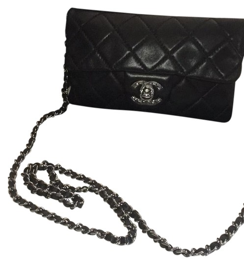 Preload https://item4.tradesy.com/images/chanel-flapbag-black-lambskin-leather-cross-body-bag-21569763-0-1.jpg?width=440&height=440