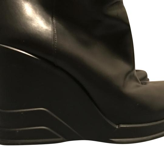 Preload https://img-static.tradesy.com/item/21570877/prada-black-collector-bootsbooties-size-us-7-regular-m-b-0-12-540-540.jpg