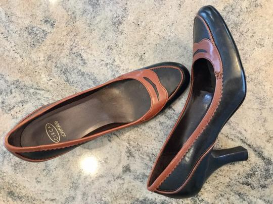 Preload https://item3.tradesy.com/images/circa-joan-and-david-black-and-brown-josia-spectator-penny-loafer-pumps-size-us-85-regular-m-b-21571652-0-0.jpg?width=440&height=440