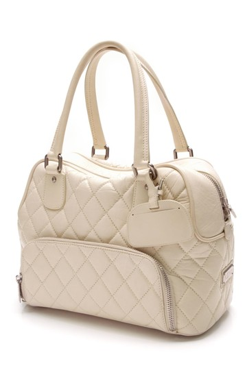 Preload https://item5.tradesy.com/images/chanel-ivory-quilted-paris-new-york-small-shoe-luggage-white-lambskin-leather-weekendtravel-bag-21571689-0-0.jpg?width=440&height=440