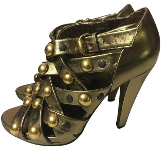 Preload https://item2.tradesy.com/images/gucci-babouska-studded-strappy-peep-hole-sandal-gold-formal-shoes-size-us-65-regular-m-b-21572226-0-2.jpg?width=440&height=440