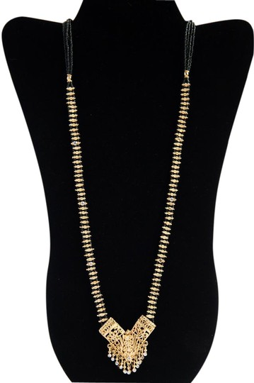 Preload https://item5.tradesy.com/images/black-long-india-inspiration-necklace-21572529-0-1.jpg?width=440&height=440