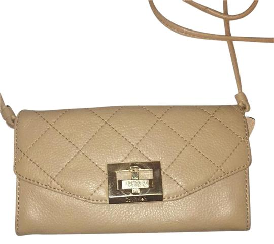 Preload https://img-static.tradesy.com/item/21572654/calvin-klein-like-new-quilted-pebble-tan-leather-cross-body-bag-0-2-540-540.jpg