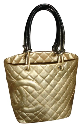 Preload https://item2.tradesy.com/images/chanel-cambon-stunning-italy-gold-black-lambskin-leather-tote-21572671-0-1.jpg?width=440&height=440
