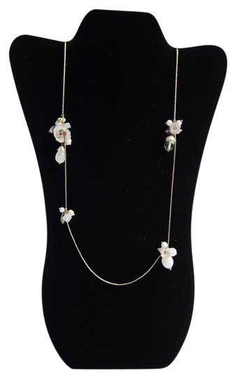 Preload https://img-static.tradesy.com/item/21572783/anthropologie-gold-tone-pink-and-green-long-with-white-flowers-necklace-0-1-540-540.jpg