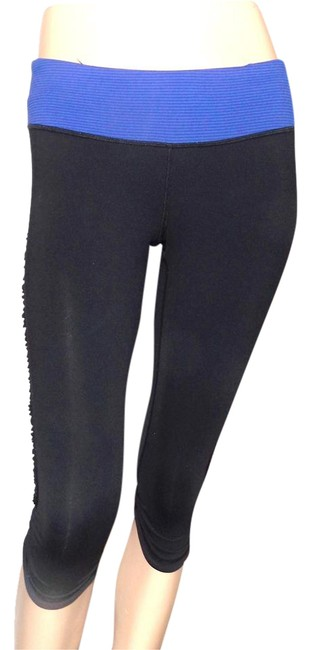 Preload https://item3.tradesy.com/images/lululemon-black-with-purple-activewear-capriscrops-size-6-s-28-21574417-0-1.jpg?width=400&height=650