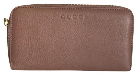 Preload https://item1.tradesy.com/images/gucci-pink-tan-leather-with-zipper-around-wallet-21574855-0-1.jpg?width=440&height=440