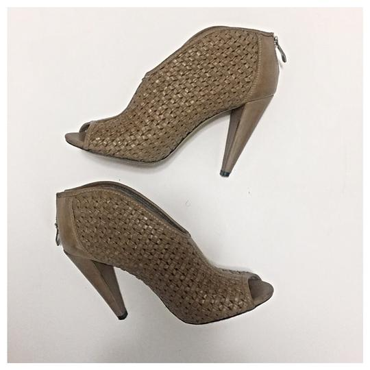 Preload https://item4.tradesy.com/images/vince-camuto-plunge-peep-bootsbooties-size-us-9-regular-m-b-21575998-0-0.jpg?width=440&height=440
