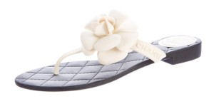 Chanel Jelly Camellia Interlocking Cc Floral Embellished White, Black, Gold Sandals