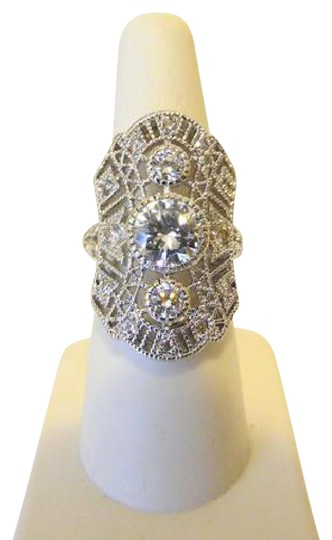 Preload https://item1.tradesy.com/images/real-collectibles-by-adrienne-silvertone-edwardian-495ctw-diamonite-ring-21576370-0-2.jpg?width=440&height=440