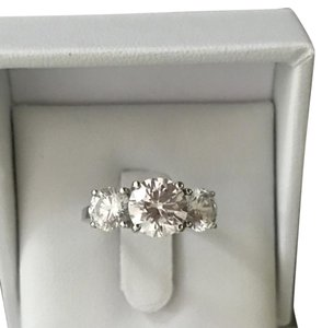 Swarovski 4 carat total weight and 14 K stamped into the ring