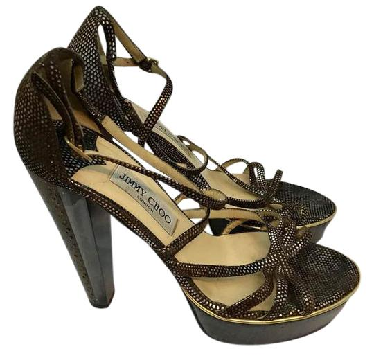 Preload https://img-static.tradesy.com/item/21589662/jimmy-choo-python-print-brown-leather-wooden-and-lucite-trim-heels-40-platforms-size-us-95-wide-c-d-0-1-540-540.jpg