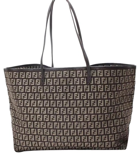 Preload https://img-static.tradesy.com/item/21589831/dark-brown-canvas-and-leather-piping-tote-0-1-540-540.jpg