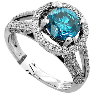 ABC Jewelry Fashion ring with a blue (treated) diamond surrounded by 1.25cttw roun