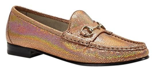 Preload https://item5.tradesy.com/images/gucci-salmon-horsebit-loafer-in-crackled-metallic-leather-385-flats-size-us-85-regular-m-b-2159524-0-0.jpg?width=440&height=440