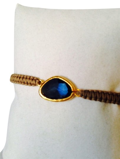 Preload https://item5.tradesy.com/images/tai-bluebeige-faceted-crystal-woven-cord-adjustable-bracelet-2159909-0-0.jpg?width=440&height=440