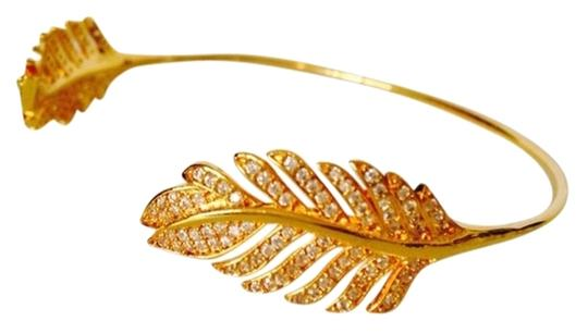 Preload https://item3.tradesy.com/images/tai-gold-14kt-yellow-gold-plated-and-crystal-feather-pinch-bracelet-2160022-0-0.jpg?width=440&height=440