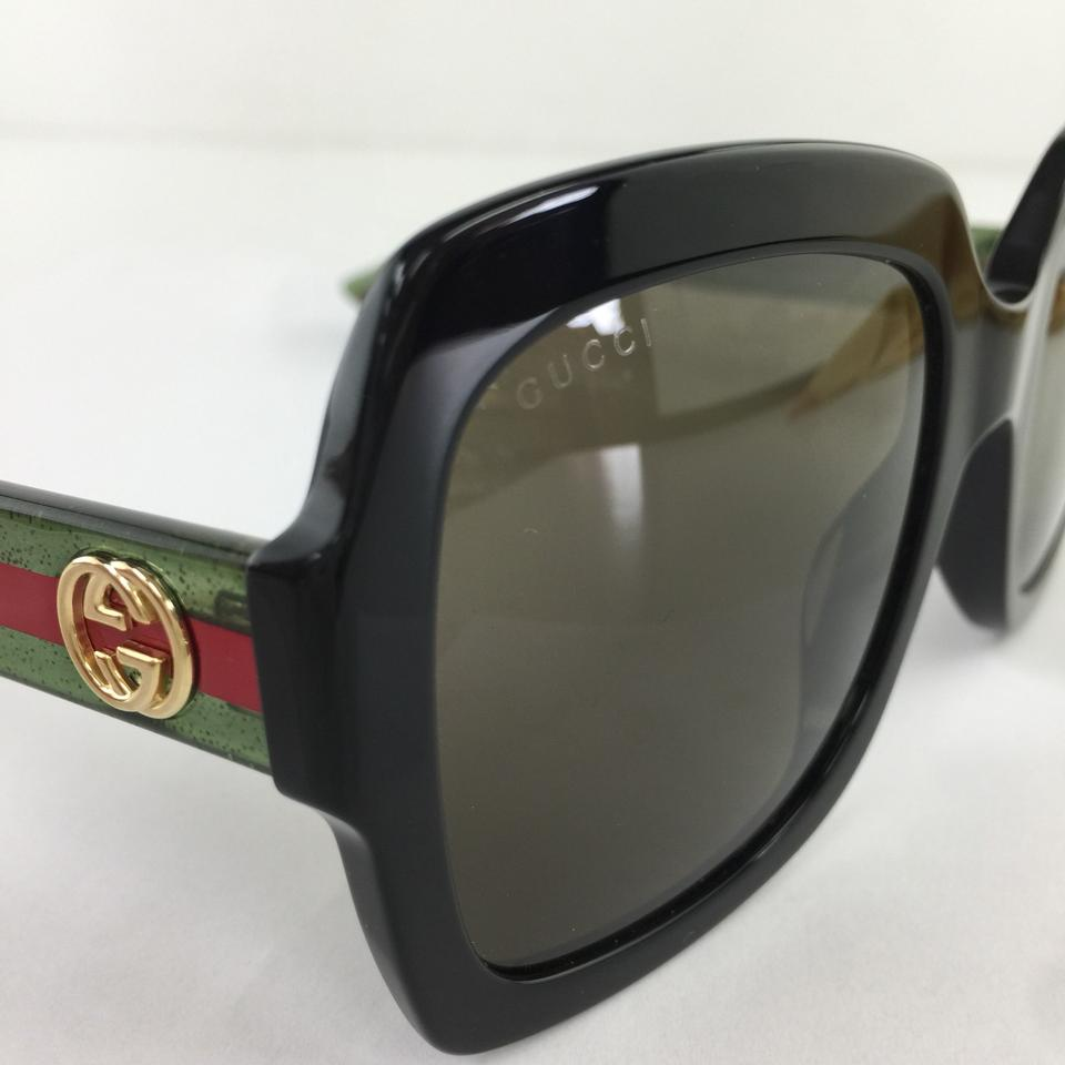 3771ba2b38f Gucci Authentic Oversized Black GG0036S 002 Green Lens Gold Red Logo Temple  Sunglasses Image 9. 12345678910