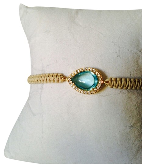 Preload https://item2.tradesy.com/images/tai-bluebeige-topaz-cabochon-and-crystal-cord-bracelet-2160421-0-0.jpg?width=440&height=440