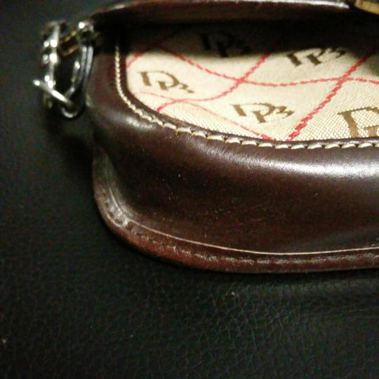 Dooney & Bourke Wristlet in Browns, tans and red.