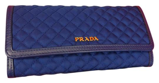 Preload https://img-static.tradesy.com/item/21608667/prada-navy-bluette-blue-quilted-nylon-leather-continental-wid-holder-wallet-0-3-540-540.jpg