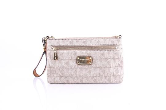 Preload https://img-static.tradesy.com/item/21608740/michael-kors-jet-set-item-wristlet-dark-khaki-wallet-0-0-540-540.jpg