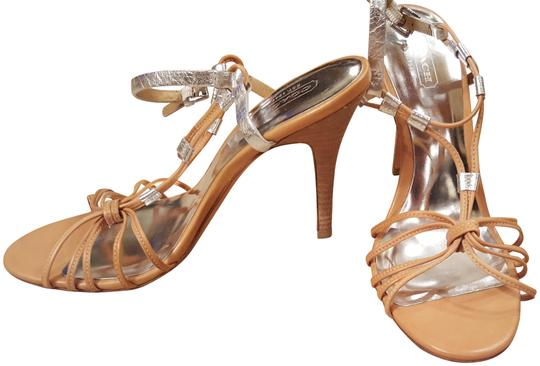 Preload https://img-static.tradesy.com/item/21610213/coach-tan-with-silver-accents-strappy-heel-pumps-size-us-7-regular-m-b-0-3-540-540.jpg