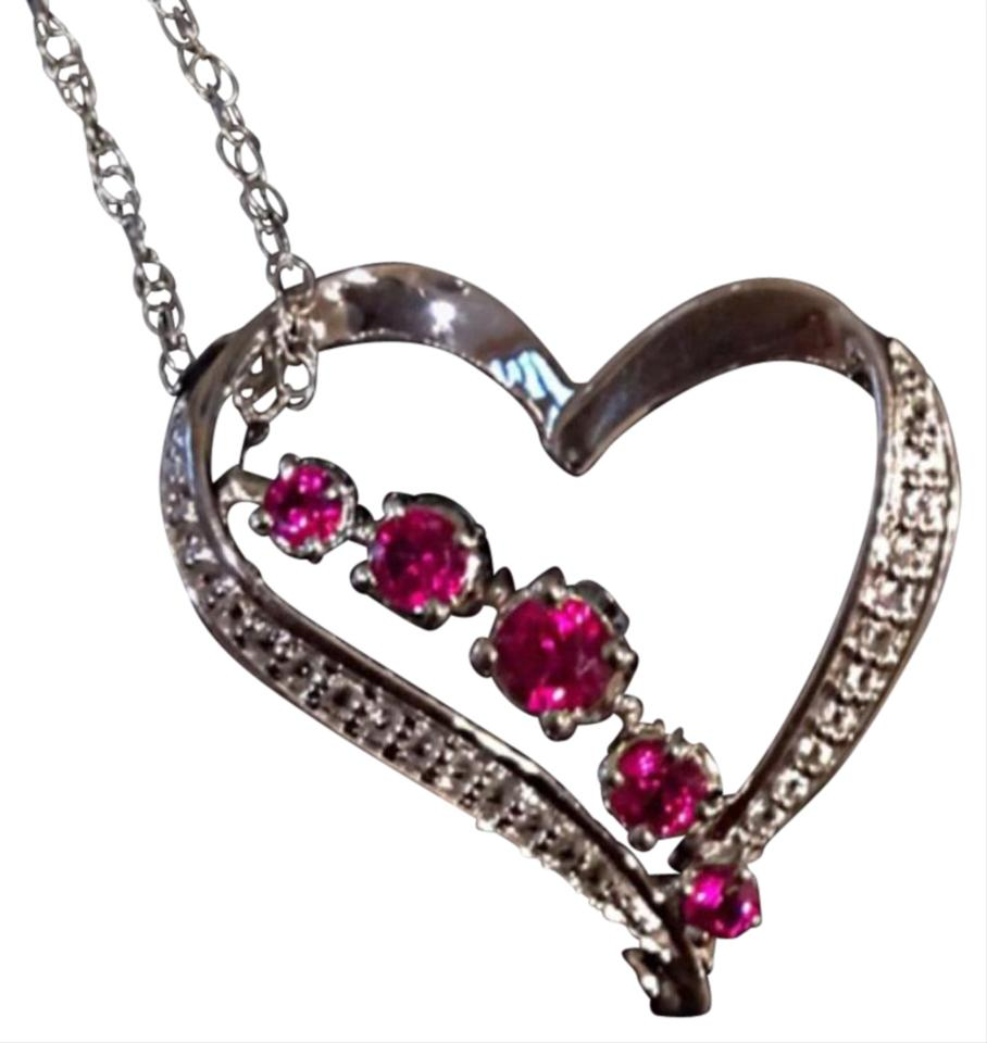 184f9839e Below skim through some more hot deals we found for you on Kay Jewelers.The  heart shaped ruby is so cool and the shape of the metal and diamonds that  form a ...