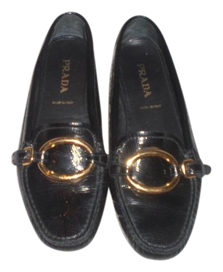 Preload https://img-static.tradesy.com/item/21610561/prada-black-patent-leather-loafer-with-gold-rings-flats-size-us-75-narrow-aa-n-0-1-540-540.jpg