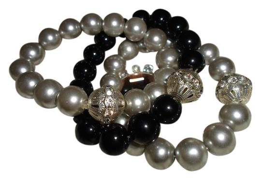 Preload https://item5.tradesy.com/images/other-gray-black-stretch-faux-pearl-bracelets-wcrystal-detail-2161599-0-0.jpg?width=440&height=440