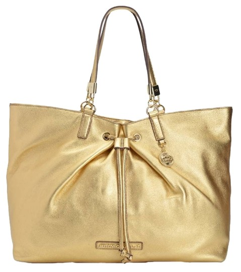 Preload https://item3.tradesy.com/images/juicy-couture-large-luxurious-metallic-hardware-gold-leather-tote-2162887-0-0.jpg?width=440&height=440