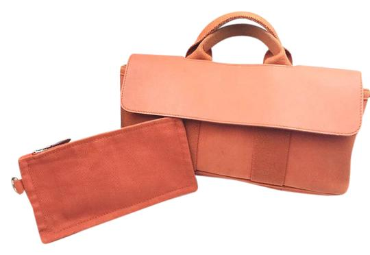 Preload https://item2.tradesy.com/images/hermes-valparaiso-pm-handbag-orange-canvas-leather-clutch-21629926-0-1.jpg?width=440&height=440