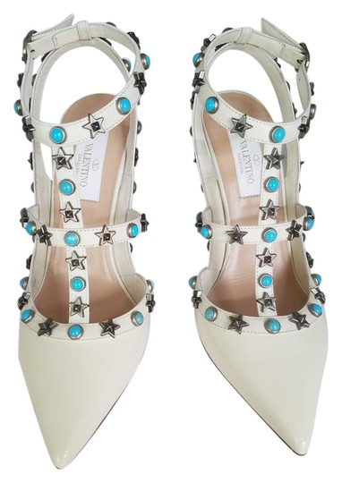 Preload https://img-static.tradesy.com/item/21632021/valentino-ivory-starstud-turquoise-patent-leather-limited-edition-formal-shoes-size-eu-36-approx-us-0-2-540-540.jpg