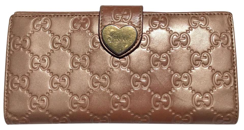 e80c80503077 Gucci Tan Gold Long Signature Heart French Flap Wallet - Tradesy