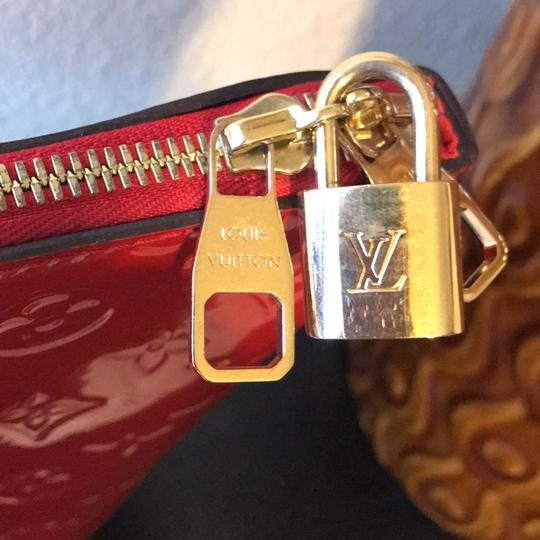 Louis Vuitton Satchel in red with gold hardware Image 1