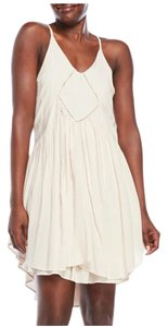 Romeo & Juliet Couture short dress Canvas White Bohemian Sleeveless Lace Trim Racer-back on Tradesy