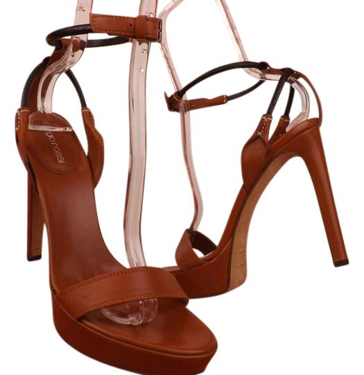 Preload https://img-static.tradesy.com/item/21643446/sergio-rossi-brown-leather-ankle-strap-pumps-95-sandals-size-eu-395-approx-us-95-regular-m-b-0-1-540-540.jpg