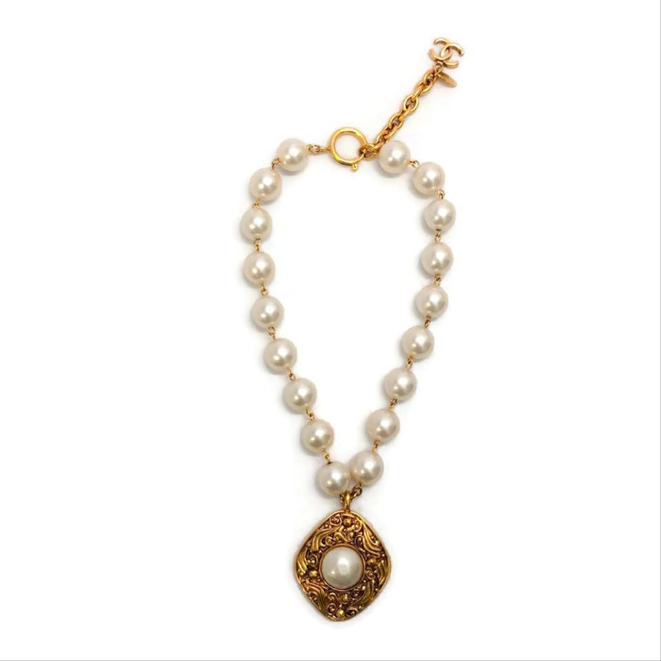 Chanel gold vintage pearl with drop necklace tradesy chanel vintage pearl necklace with gold drop aloadofball Image collections