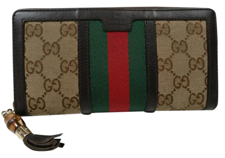 5e35af78e835c9 Gucci Rania Web Gg Leather Zip Around Wallet /Clutch Brown Canvas ...