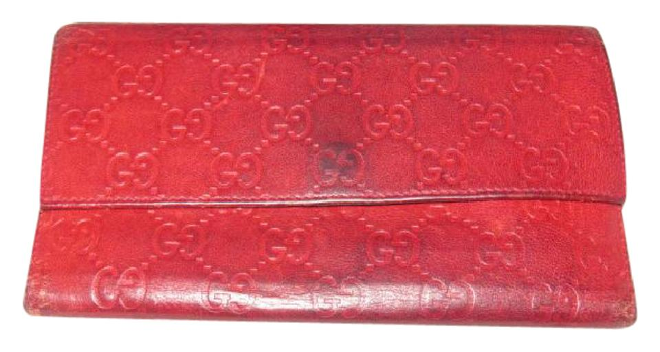 bce8aa343a1 Gucci Deep Red Leather with An Embossed G Print Xl Wallets Designer ...