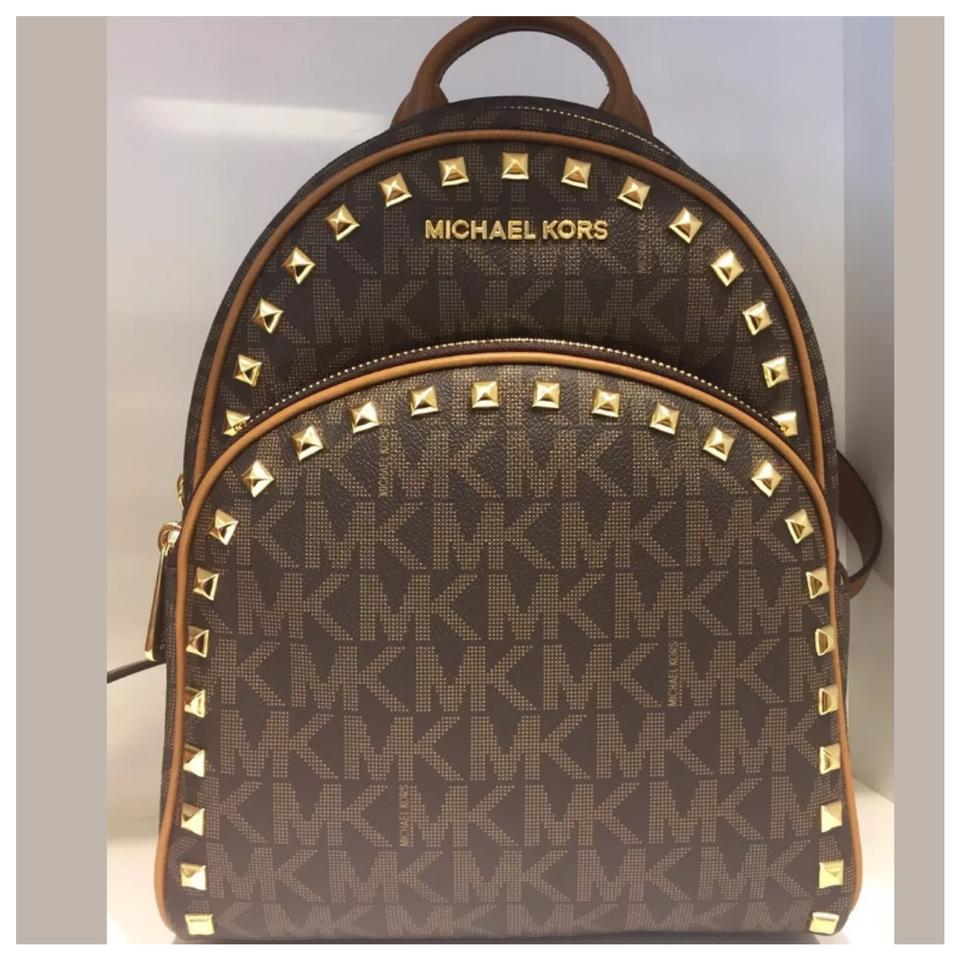 228ef265725ba8 Michael Kors Mk Abbey Md Frame Out Studded Brown Backpack - Tradesy