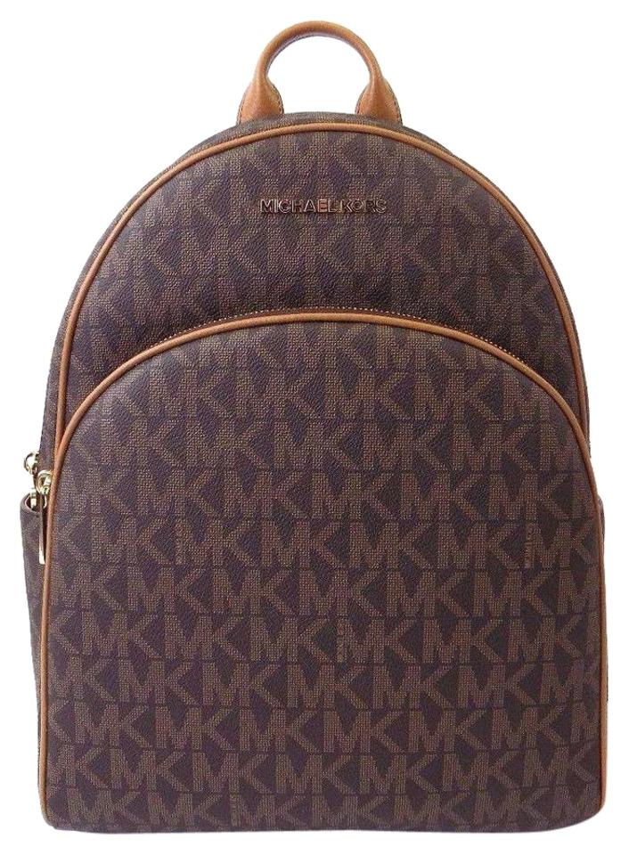 cc679b4189a4 Michael Kors Abbey Monogram Leather Straps Large Flap Backpack Image 0 ...