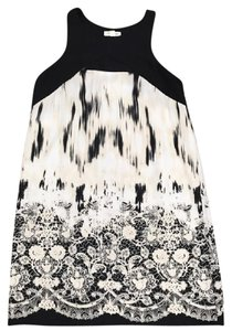 Silence + Noise short dress Black and White Urban Outfitters Cut Out on Tradesy