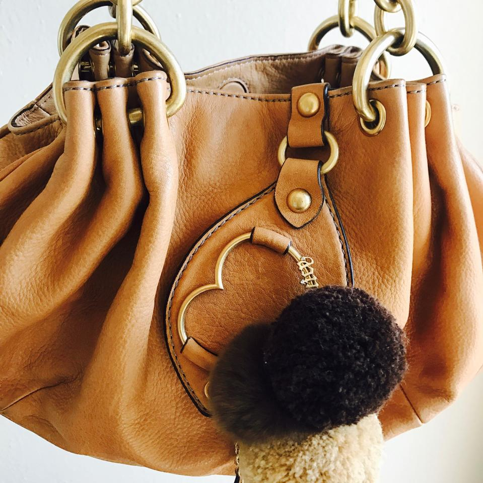 e8e5bc7aae9c Juicy Couture Gold Chain Baby Fluffy Caramel Leather Hobo Bag - Tradesy
