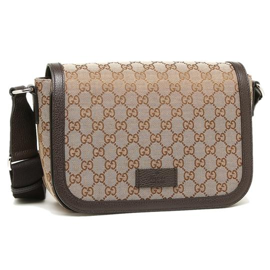 Preload https://item1.tradesy.com/images/gucci-unisex-tan-and-brown-canvas-leather-cross-body-bag-21692030-0-0.jpg?width=440&height=440
