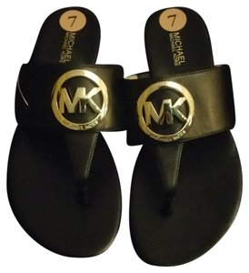 Michael Kors Black and gold Sandals