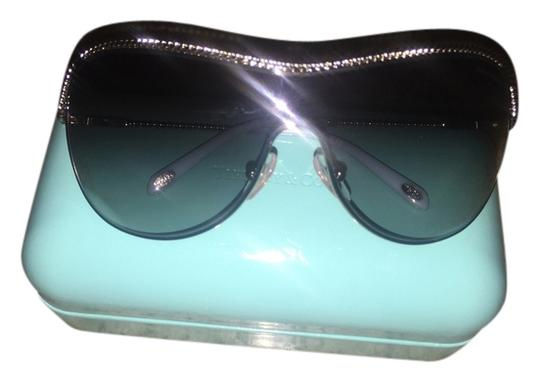 Preload https://item1.tradesy.com/images/tiffany-and-co-silver-twisted-shield-sunglasses-2170095-0-0.jpg?width=440&height=440