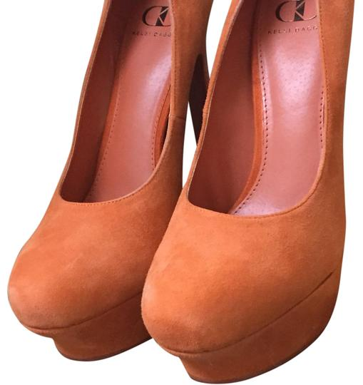 Preload https://img-static.tradesy.com/item/21707585/kelsi-dagger-tangerine-orange-suede-platforms-size-us-10-regular-m-b-0-1-540-540.jpg