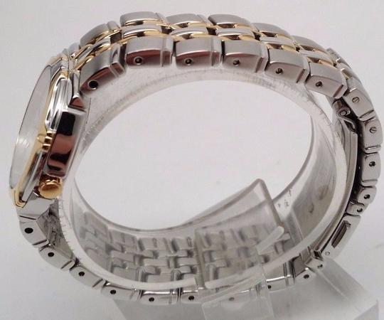 Seiko SEIKO DRESS SILVER DIAL DATE TWO-TONE STAINLESS STEEL WOMEN'S WATCH S